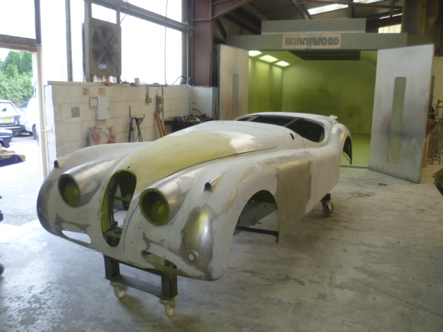Front view of Jaguar XK140, body panelled up, gapped and filled.
